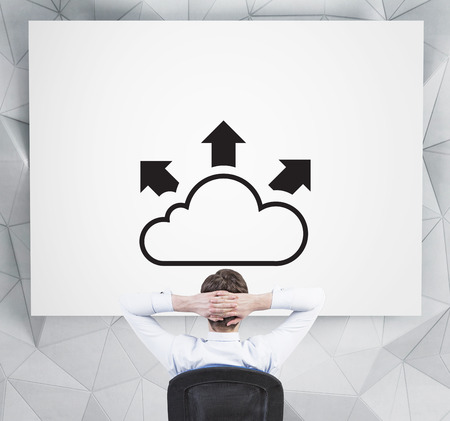 businessman looking at drawing cloud with arrow on placard photo