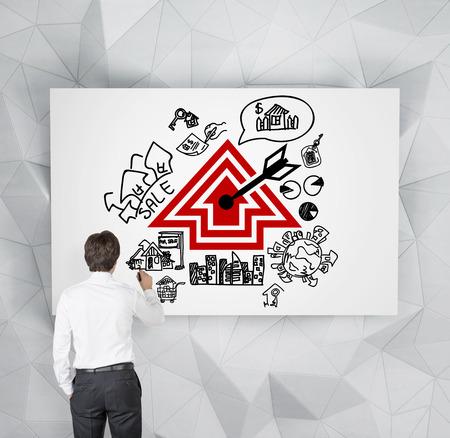 realtor: realtor drawing real estate scheme on poster Stock Photo