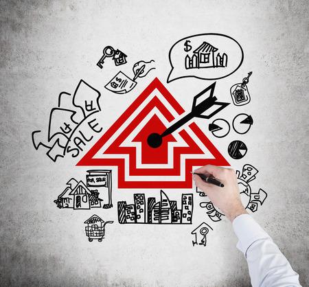 realtor: hand realtor drawing real estate scheme, close up
