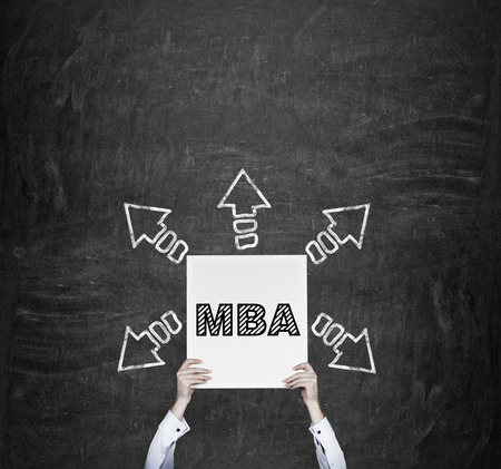 alumnus: hands holding poster with drawing MBA symbol Stock Photo