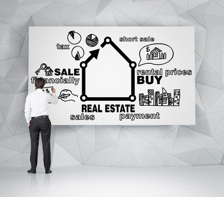 realtor: realtor drawing real estate concept on desk