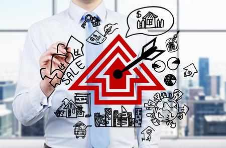 realtor: realtor drawing real estate scheme, close up Stock Photo