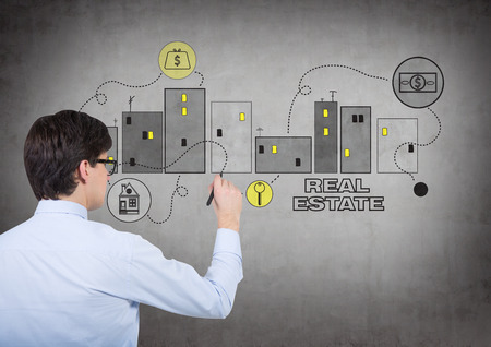 realtor: realtor drawing real estate symbol on wall Stock Photo