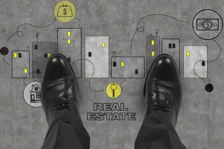 realtor: leg realtor standing on real estate symbol Stock Photo