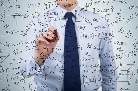 young businessman drawing mathematics equations and formulas