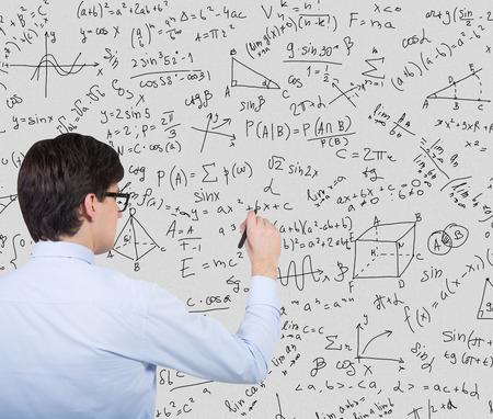 equations: businessman drawing mathematics equations and formulas