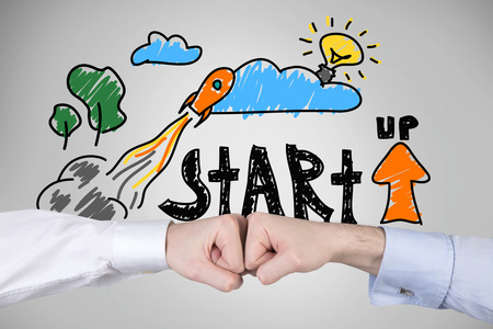 company innovation: two fist and drawing start up concept
