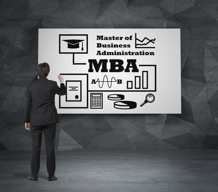 mba: businessman drawing mba concept on desk