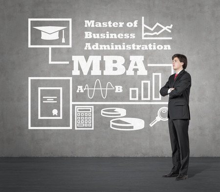 mba: businessman thinking and drawing mba concept on wall