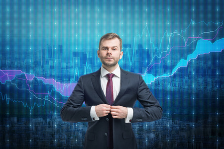 stock listing: Trader businessman stand over stock market screen