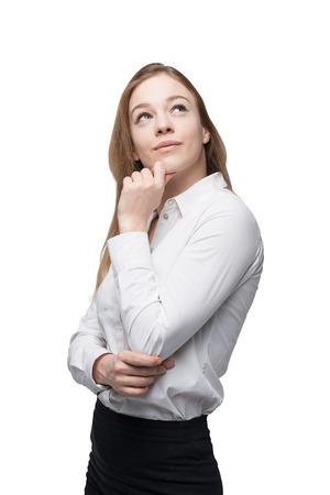 introspective: Young business lady is thinking about something. Isolated.