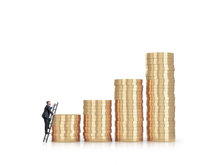 Businessman is climbing to the financial success. Isolated on white photo