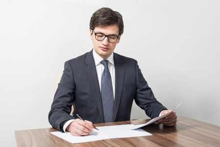 Young businessman is checking contracts photo