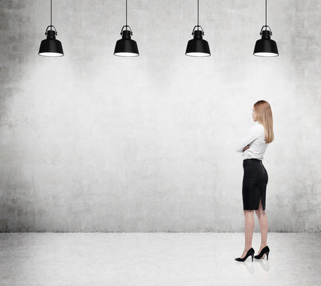 Businesswoman is looking at the concrete wall Stock Photo