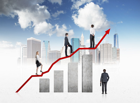 A concept of business development. Business people on the chart. New York background. photo