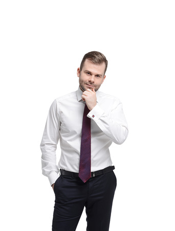 musing: Young businessman in a formal clothes. Isolated. Stock Photo