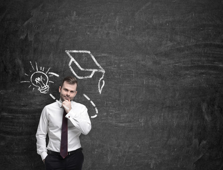 research education: Young man is thinking about further education,