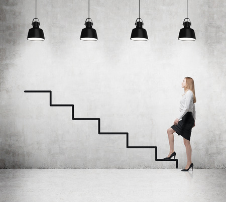 concrete stairs: Young woman is going up to the career ladder