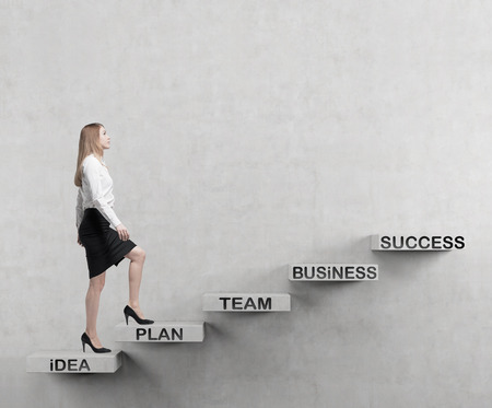 start business: Young business woman is going up to the stairs. A concept of successful business project