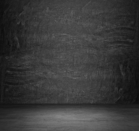 Dark concrete empty room. The chalkboard on the whole wall. photo