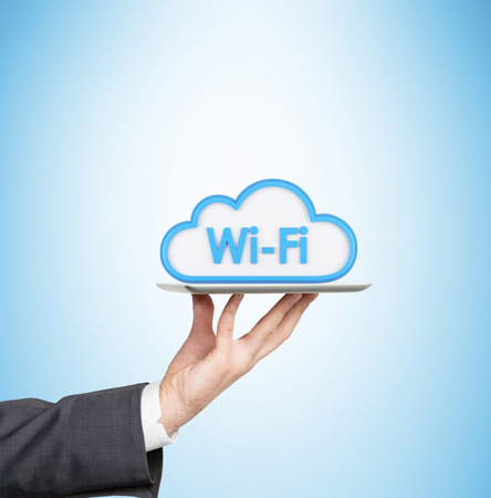 portability: A hand is holding a tablet with the icon of the wifi cloud Stock Photo