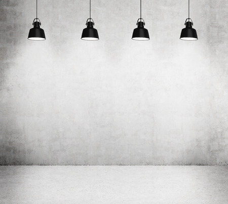 architectural lighting design: Concrete room with four black lamps.