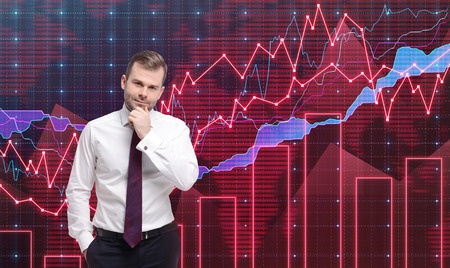 buy shares: Trader is standing in front of the forex graph. A metaphor of international financial consulting. Red background. Stock Photo
