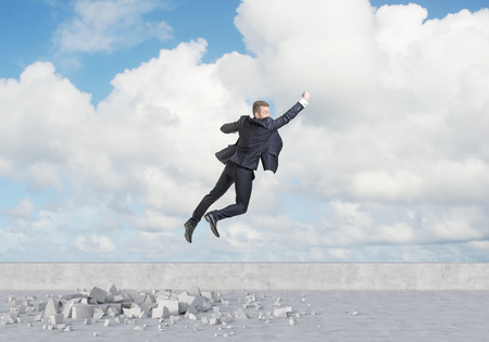 Businessman is flying over the clouds. A concept of the success.