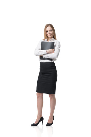 office workers: Beautiful young business lady is holding a black folder. Isolated on white background.