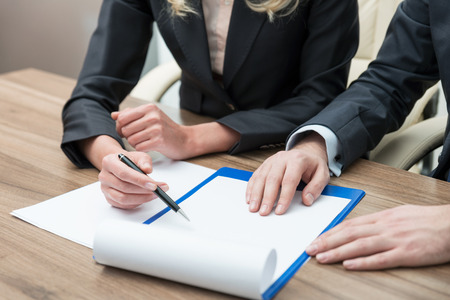 legal contract: Close up hands of working process. Legal contract negotiation. A concept of teamwork.