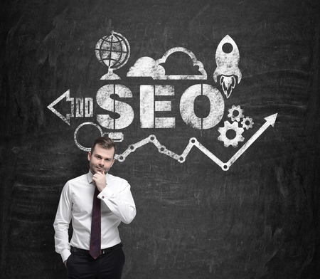 optimisation: Young businessman is thinking about SEO. Stock Photo