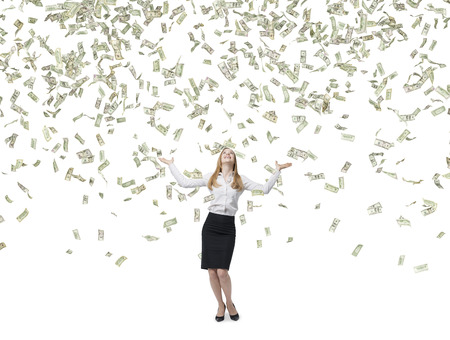raining: Beautiful blonde business woman is happy about flying dollars notes. Isolated on white background. Stock Photo
