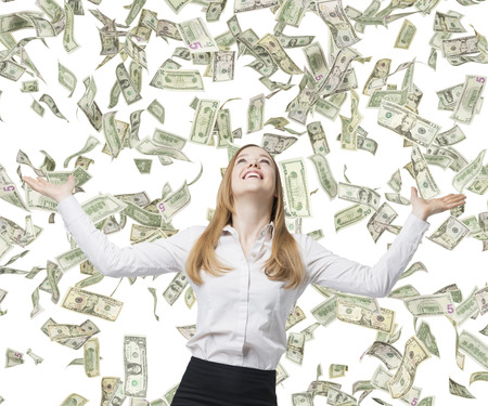 money savings: Beautiful blonde business woman is happy about flying dollar notes. Stock Photo