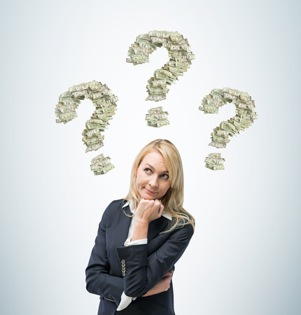 unresolved: Beautiful blonde business woman is thinking about business ideas. Stock Photo