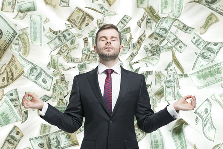 cash money: Joven empresario meditativa.