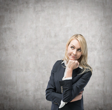 reverie: Beautiful blonde business woman is thinking about business issues.