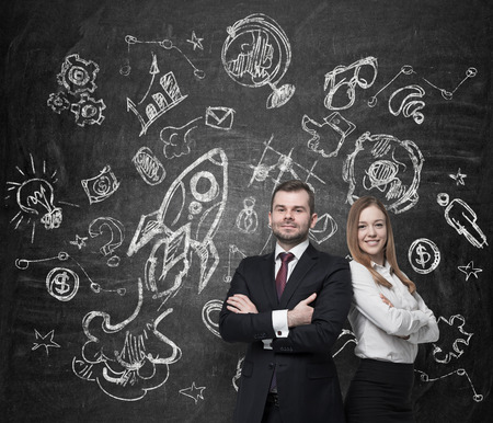 rocket man: Confident business couple. A concept of teamwork, the development plans and future perspectives. Stock Photo