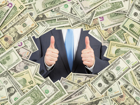 both sides: a man with thumbs up inside the US Dollar bills frame. All nominal bills both sides. Front and reverse. Stock Photo