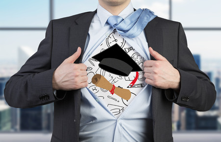 doctoral: Young student is tearing the shirt. Graduation attributes are drawn on the chest. The concept of the graduation.