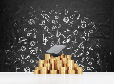 financial education: Graduation hat is laying on the coins pyramid. A concept of a high price for the university education. Education icons background.