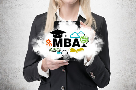 business degree: Blonde business lady is holding a cloud with business education icons. A concept of the MBA degree.