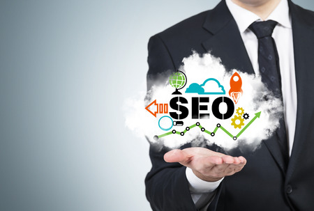 A manager is holding a cloud with the SEO cloud.