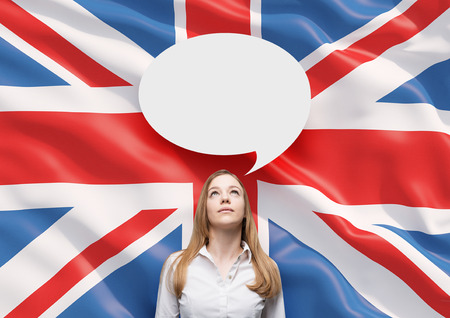 great britain flag: Beautiful woman and the blank speech bubble above the head. Great Britain flag as a background. Stock Photo