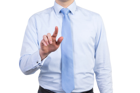 entering information: A male in a formal shirt with a tie is pushing the invisible button. Isolated. Stock Photo