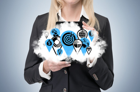 streamlining: Business woman is holding a cloud with business icons as a concept of successful business management.