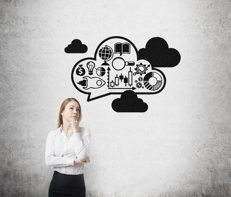 expanding: Young business lady is thinking about expanding of the business ideas. Drawn business icons and clouds on the wall.