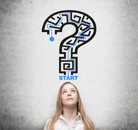 solved maze puzzle: Beautiful woman is looking for the way how to solve the maze in a form of the question mark