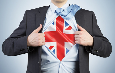 great britain flag: A man tearing the shirt. Great Britain flag on the chest. Stock Photo