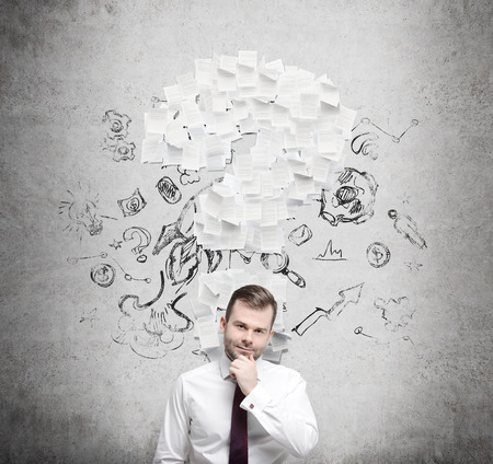 businessman pondering documents: Confident businessman is thinking about the question mark which consists of the contract pages. Concrete background.