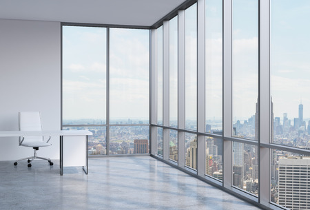 high view: Work space in a modern panoramic corner office in New York. Stock Photo
